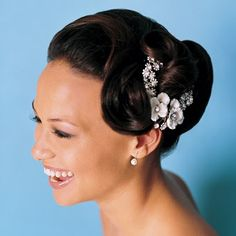 Elegant wedding hairstyles and hairdos for African-American women and brides-to-be featuring relaxed hair, natural hair and braids.