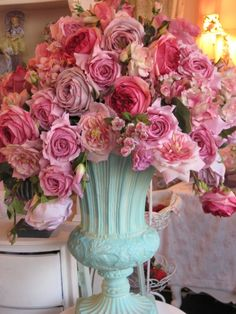 Pink flowers in a aqua vase.  Nooks & Crannies