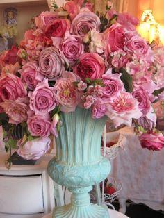 Pink flowers in a aqua vase.  Nooks & Crannies