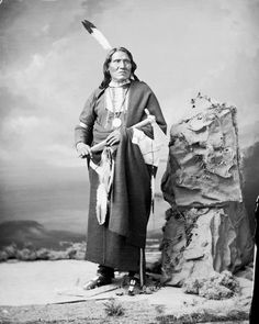 Portrait (Front) of We-Ca-Ton-Ga or Wase-A-Tonga (Big Snake), Brother of Mon-Chu-Non-Zhin (Standing Bear) - Ponca  in Partial Native Dress with Peace Medal and Breastplate and Holding Pipe-tomahawk and Bag 14 NOV 1877 by William Henry Jackson (1843-1942)