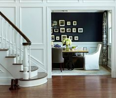 white wood paneled entry, cherry wood floors, curved staircase, dark royal blue dining room with white wainscoting (Benjamin Moore, Deep Royal) - CoLORS Dining Room Wainscoting, Dining Room Paint, Dining Room Blue, Dining Room Design, Dining Rooms, Dining Table, Dining Chairs, Wainscoting Ideas, Navy Walls