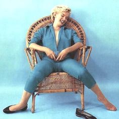 Marilyn. Wickerchair sitting. Photo by Milton Greene, 1954.