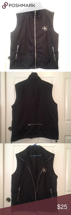 Calvin Klein Black Full Zipper Windbreaker Vest This is an Awesome Windbreaker Vest! In excellent condition only worn a few times! 100% nylon and size L/XL. No rips, tears or funny smells! Unisex Calvin Klein Jackets & Coats Vests