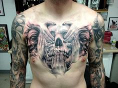 Sugar skull tattoo design on chest