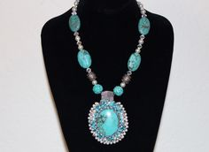 Turquoise and pearl necklace designed by Gloria Rosenbaum Designs.