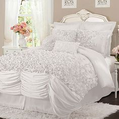 Add feminine-chic flair to your master suite or guest bedroom with this faux silk comforter set, showcasing layers of ruched detailing and hand-sewn bows.  ...
