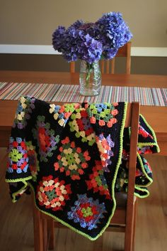 Granny Squares, updated bordered in black.  Love the lime green edging with the black.