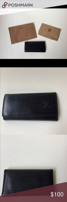 Louis Vuitton Epi Leather Key Pouch Louis Vuitton Epi Key Pouch comes with gold-tone hardware, 4 interior key rings and snap closure at front flap. Has normal wear throughout and rubbing on back flap. Date code reads L00932. Louis Vuitton Accessories Key & Card Holders