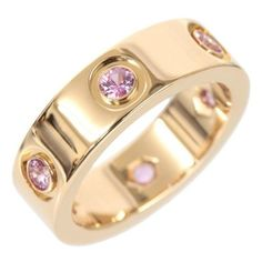 Pre-owned Cartier 18K Rose Gold Full Pink Sapphire Love Ring ($2,320) ❤ liked on Polyvore featuring jewelry, rings, rose gold wedding rings, band rings, pink cocktail ring, wedding band rings and cocktail rings