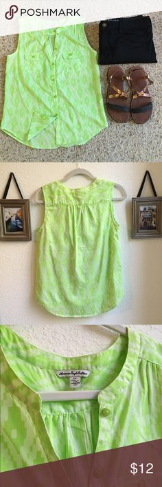 """GUC American Eagle Tank Worn 3 times; button up American eagle tank top. There was a small snag in the back of the shirt (please see the 4th photo). Lime green and white Ikat pattern. Chest is 17.5"""". Length is 22"""". 80% polyester, 20% cotton. American Eagle Outfitters Tops Tank Tops"""