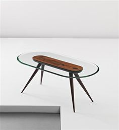 Pietro Chiesa; Rosewood and Glass Coffee Table for Fontana Arte, 1940s.