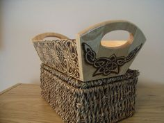 Wooden basket decorated with Celtic designs.