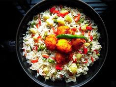 Fried rice recipe is a dish that hails from China. The version that is popular in India is the adaptation that fits Indian cuisine. Hence, everybody's favourite fried rice is actually an Indo-Chinese dish. Preparing this dish is exceptionally simple and there are not too many ingredients.