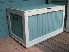 small outdoor storage, organizing, outdoor living, Bench storage for a porch perfect for storing seat cushions or toys