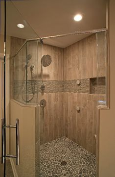 One of our favorite walk-in shower ideas is incorporating pebble floors to prevent slipping.