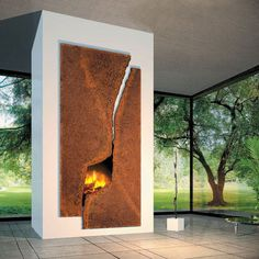 sculptural steel fireplace surround by Focus Fireplaces.  Contemporary living room by CF + D custom fireplace design.