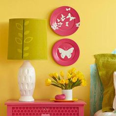 Refurbish old dishes with fresh paint and a striking silhouette. Print and cut out an animal or image. Secure outline using tape or a small heavy object. Spray paint over silhouette items. We chose a bright matte pink to coordinate with the furniture.