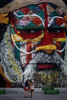 "corallorosso: "" Rio de Janeiro, Brazil People take photos in front of Etnias, a large mural by local graffiti artist Eduardo Kobra at Porto Maravilha Photograph: Diego Azubel """