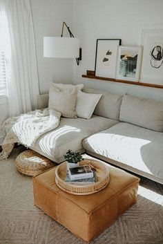 modern living room decor with gray modern sectional sofa, leather ottoman and shelf above sofa modern living room decor, neutral living room decor with white walls and coffee table decor room Ideas Living Room Decor With White Walls, Boho Living Room, Living Room Modern, Home And Living, Tiny Living, Bohemian Living, Decorating With White Walls, Tan Couch Decor, Living Area