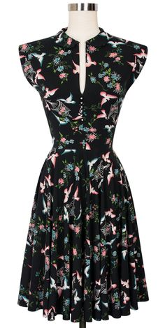 The Hopscotch Dress returns in our beautiful, retro-inspired Lovebirds print! This 1950s style frock features a Peter Pan collar followed by a line of decorative rhinestone buttons that give your look a little extra sparkle. The front and back waist and bust darts, invisible side zipper, and bold circle skirt offer that classic retro silhouette, while the long shoulder seam features the look of a cap sleeve without the fuss. The functional pockets and upper back cutout are sweet surprises…