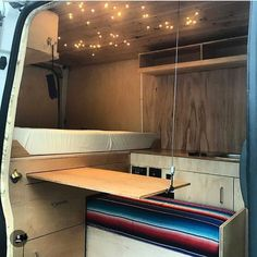 Van Life Storage and Organization Ideas Using a hidden or slide out table in a campervan conversion is a great way to save space. You can add it to your own DIY van build for extra organization. Great article with advice on how to design your kitchen, bat Sprinter Camper, Campervan Conversions Layout, Van Kitchen, Kitchen Decor, Kitchen Cupboard, Hidden Shelf, Van Bed, Sliding Table, Campervan Interior