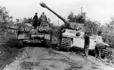 A Sturmpanzer IV passes a disabled Tiger I whose crew is preparing it for towing by a Famo 9 ton halftrack. This photo was taken in the Anzio area.