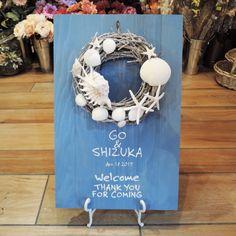 波の音が聞こえてきそう♡貝殻やヒトデを使ったリースがキュートなボード♪夏の結婚式にぴったりの青いウェルカムボードにまとめ一覧♡
