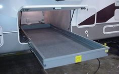 How to install a slding storage tray in an RV