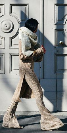 Gold knit tunic and matching flared pants with an oversized cream chunky scarf