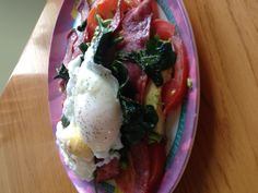 Poached eggs over bacon, avocado, spinach, and tomato. Could swap portabellas instead of tomatoes too! #Primal