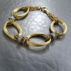 14k satin finished gold link bracelet accented by diamonds with a total carat weight of 0.85ctw.