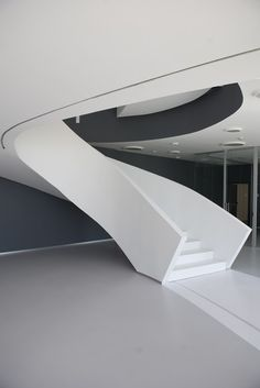 A sculptural staircase in HI-MACS® for a contract project in between architecture and design