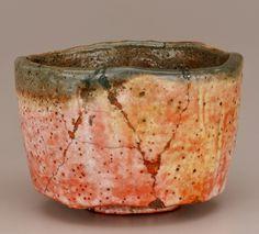 Tea bowl, unknown Raku ware workshop. Style of Hon'ami Kōetsu 本阿弥光悦 (1558-1637). Edo period or Meiji era, 19th century. Japan. Raku-type earthenware with red slip under milky glaze; smoke-blackened rim; red lacquer repairs