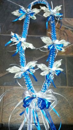 Double braided ribbon lei with money butterflies for Graduation.
