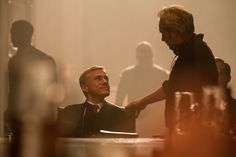 """Christophe Waltz talks with director Sam Mendes on the set of """"Spectre"""", 2015. Spectre 2015, Sam Mendes, Christoph Waltz, James Bond, Cinematography, Daddy, Music, Movies, Fictional Characters"""