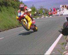 Caption:  Rounding the Waterworks - Junior TT 2000  Rider:  DavidJefferies  Date:  June 2000