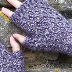 Deep purple-grey and silver beads evoke the angry clouds and rain of a summer storm. A beaded eyelet and gathered yarn over panel covers the back of the hand and wrist, with the palm, top and bottom cuffs all worked in garter stitch. The mitts are worked flat and seamed on the outer edge using mattress stitch.