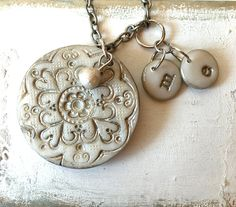 Grandmother Silver Personalized Necklace, Children and Grandchildren Gift for Nana and Mama, Mothers day 2017 Nana Gift  A very special piece for Nana or Mom. The medallion is a delicate lace inspired texture in white translucent clay with silver acrylic accents (Measures 1.75)  Pick your desired number of kids initial charms from the right menu (they measure 0,65) Ill attache them graciously to the chain.  The chain is 30  ----------------------------------------------- I make every single…