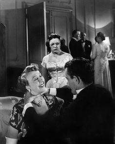Alfred Hitchcock. STRANGERS ON A TRAIN (1951)  starring Farley Grangers, Ruth Roman, Robert Walker, and Hitchcock's daughter, Patricia Hitchcock.