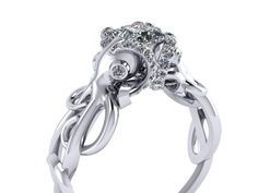 These loving cute octopuses are entwined around a .50ct-/+ Princess cut diamond. Set along the tentacles is set 1.3mm round white diamonds.The