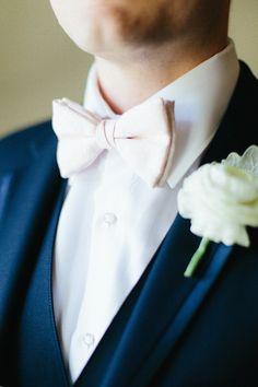 Navy suit + pink bow tie