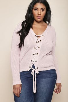 af0a910aa88f5 An edgy — and dare we say sexy — plus size sweater. Features an open
