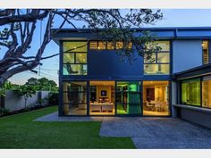 This modern and eco-friendly home in Bayswater features polished concrete floors and floor to ceiling glass.