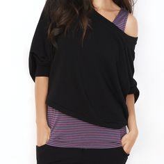 There's just something different about the proportions of this slouchy black off-the-shoulder top and multi-pin-striped tank, that I love! Little twist on on a trendy look.