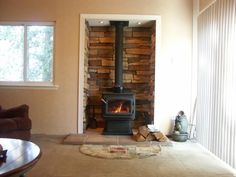 Step top Quadra Fire stove in stoned alcove and tile hearth.  Great design.