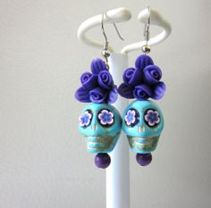 Hey, I found this really awesome Etsy listing at https://www.etsy.com/listing/165405295/sugar-skull-earrings-blue-purple-rose