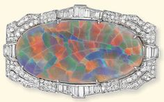 AN ART DECO OPAL AND DIAMOND BROOCH The oval-shaped harlequin opal mounted within a single-cut diamond surround to the baguette-cut diamond collet detail, circa 1930, 5.7cm wide. Price Realized £15,000 (Set Currency) ($24,615). Estimate £12,000 - £15,000 ($19,620 - $24,525).
