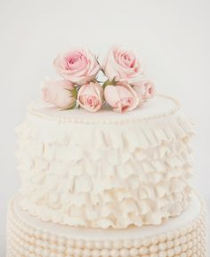 I want a ruffled layer on my wedding cake! I like the flowers and beaded layer too.