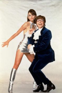"""In 1997 Mike Myers introduced his parody of James Bond movies (or rather a parody of James Bond parodies), """"Austin Powers: International Man of Mystery,"""" co-starring Elizabeth Hurley. Movie Couples Costumes, Cute Couple Halloween Costumes, Halloween Outfits, Hot Couple Costumes, Trendy Halloween, Woman Costumes, Costumes Kids, Pirate Costumes, Princess Costumes"""