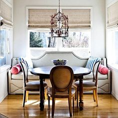 I was initially drawn to this image because of the great blinds.  I love the soft elegant drape (perfect fabric),  But  I can't stop there.  This is just a great looking nook.  From the custom banquet to the fabric selections throughout, this is one cool dining alcove.